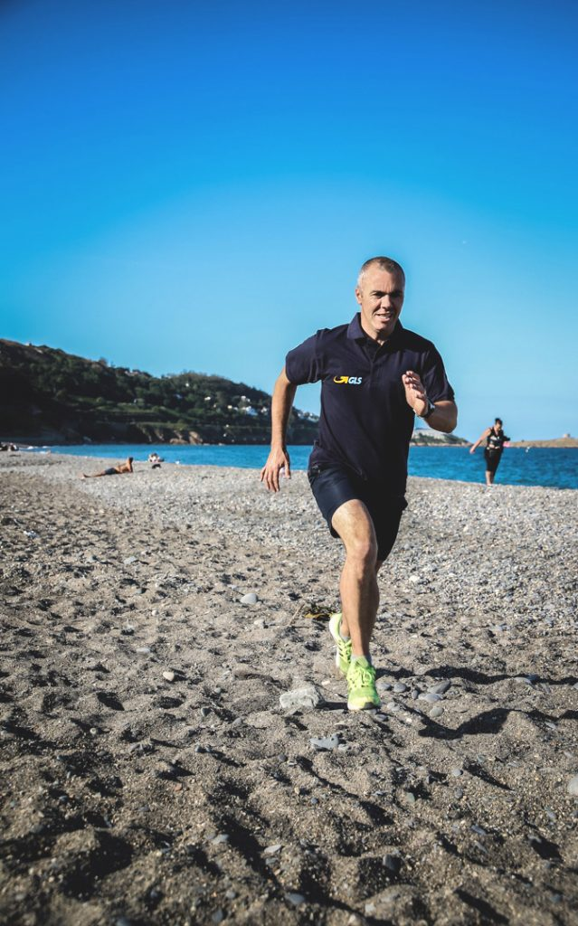 Dave hits the rocks running on Killiney Beach to train for his first triathlon                Dave's first swim in the open sea